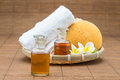 Spa bath, salt, towel sponge essential oil and flower for spa he Royalty Free Stock Photo