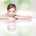 Spa beauty woman with flower beautiful face lying down amd mirror reflection concept asian Stock Photo