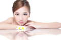 Spa beauty woman with flower beautiful face lying down amd mirror reflection concept asian Royalty Free Stock Images