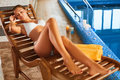 Spa Body Care. Girl Relaxing in Deck Chair Royalty Free Stock Photo