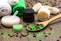Spa and cellulite busting products on wooden surface anti cosmetics with caffeine spoon with green coarse sea salt coffee beans Stock Image