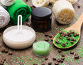Spa and cellulite busting products on wooden surface anti cosmetics with caffeine spoon with green coarse sea salt coffee beans Stock Photo