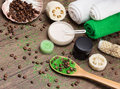 Spa and cellulite busting products on wooden surface anti cosmetics with caffeine spoon with green coarse sea salt coffee beans Stock Images