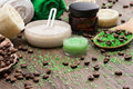 Spa and cellulite busting products on wooden surface anti cosmetics with caffeine spoon with sea salt coffee beans natural body Stock Photos