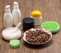 Spa and cellulite busting products on wooden surface shell filled with coffee beans natural scrubs sea salt skin care creams anti Royalty Free Stock Photography