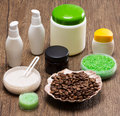 Spa and cellulite busting products on wooden surface shell filled with coffee beans natural scrubs sea salt skin care creams anti Stock Photography