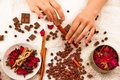 Spa composition with chocolate, coffee and hands Royalty Free Stock Photo