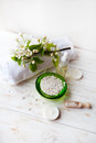 Spa composition with flowers sea salt Massage oil and towel on table