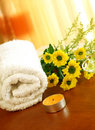 Spa composition of towel, yellow flowers and candle Stock Image