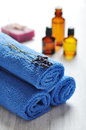 Spa concept blue towels and lavender flowers closeup Royalty Free Stock Photo
