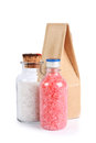 Spa concept with bottles of colorful bath salt a blue towel and a paper bag still life Royalty Free Stock Photography