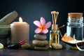 Spa concept dark background ambient lights cold stones frangipani Stock Photos