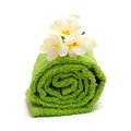 Spa concept - flower and green towel Royalty Free Stock Photography