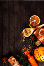 Spa concept on wooden background: Aromatic oils, salt, soap, citrus, cinnamon candles. Royalty Free Stock Photo
