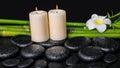 Spa concept of zen basalt stones, white flower plumeria, candles Royalty Free Stock Photo