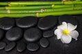 Spa concept of zen basalt stones, white flower plumeria Royalty Free Stock Photo