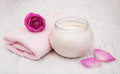 Spa essentials cream with towels and rose Royalty Free Stock Photo