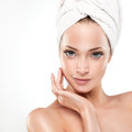 Spa girl with clean skin beautiful young woman after bath touching her face Royalty Free Stock Images