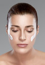 Spa girl with cream on her face skincare concept beautiful woman looking down perfect skin Royalty Free Stock Image