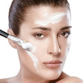 Spa girl with cream on her face skincare concept beautiful woman receiving skin care treatment perfect skin Royalty Free Stock Photos