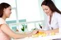 Spa hand care beautician consulting her client on Stock Image