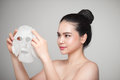 Spa, healthcare. Asian girl with a cosmetic mask. Royalty Free Stock Photo