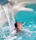 Spa hydrotherapy woman waterfall jet Stock Photo
