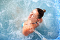 Spa hydrotherapy woman waterfall jet Stock Photos