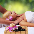 Spa massage beautiful blonde woman getting body massage outdoor beauty treatments Royalty Free Stock Images