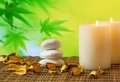 Spa massage border background with candle near stone and wood on bamboo table Royalty Free Stock Image