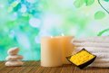 Spa massage border background with towel stacked candles and sea salt on window view Royalty Free Stock Images
