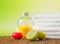 Spa massage border background with towel stacked red candle and lime on green Stock Image