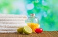Spa massage border background with towel stacked red candle and lime on green bokeh Stock Photography