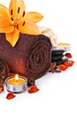Spa massage border with towel and orange lily flower Royalty Free Stock Photo