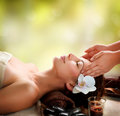 Spa massage young woman getting facial massage Stock Photo