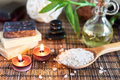 Spa with natural bath salt candles soap towels and petals Stock Photos