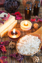 Spa with natural bath salt candles soap towels and petals Royalty Free Stock Photo