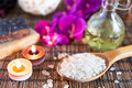 Spa with natural bath salt candles soap towels and petals Royalty Free Stock Photos