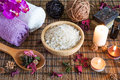 Spa with natural bath salt candles soap towels and petals Stock Photography