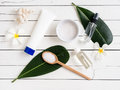 Spa products, aromatherapy oil and salt with Plumeria flower. Royalty Free Stock Photo