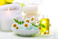 Spa relaxation theme with flowers, bath salt, essential oil and candles Royalty Free Stock Photo
