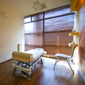 Spa room and massage bed Royalty Free Stock Photo