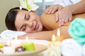 In spa salon portrait of young female enjoying the procedure of massage Stock Photo