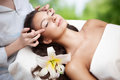 Spa salon: Young Beautiful Woman Having Facial Massage Royalty Free Stock Photo