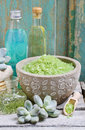 Spa set: green sea salt, scented candles, liquid soap and essent Royalty Free Stock Photo