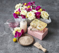 Spa set: sea salt, bars of handmade soap and liquid soap. Bouque Royalty Free Stock Photo