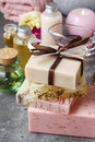 Spa set: sea salt, bars of handmade soap and liquid soap. Royalty Free Stock Photo