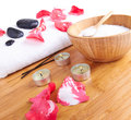 Spa setting candle flower red petals towel salt Royalty Free Stock Photography