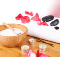 Spa setting candle flower red petals towel salt wooden background Royalty Free Stock Images