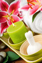 Spa setting with candle and herbal ball Royalty Free Stock Images